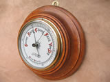 Late 19th century turned Oak aneroid barometer with ceramic dial