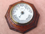 Early 20th century carved Oak aneroid barometer by Wilson Penrith, circa 1910.