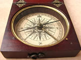 Close up view of compass dial & hand made hinges