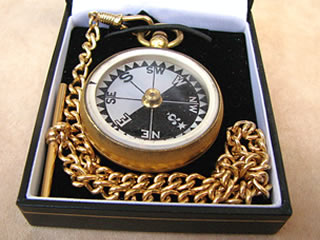 Late 19th century pocket compass with mother of pearl dial, shown in modern gift box