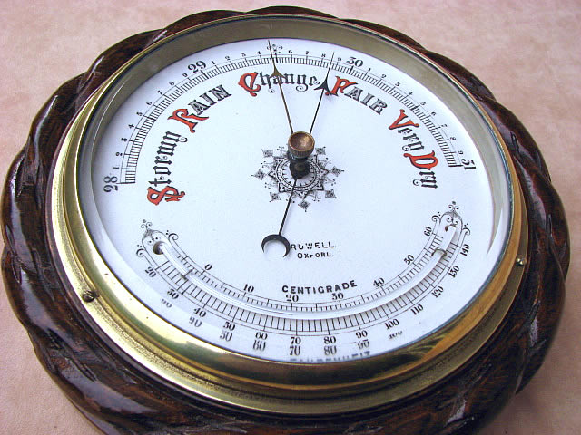 Oak cased aneroid barometer with ceramic dial & curved thermometer