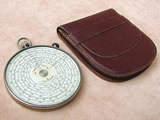 Fowlers Twelve Ten circular slide rule with leather case