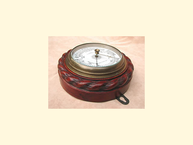 Victorian barometer with curved thermometer, in ropetwist carved oak surround