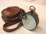 E R Watts & Son surveying aneroid barometer with leather case.