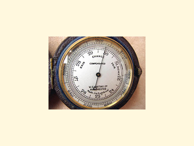 Close up view of barometer dial with altimeter scale to 8000 feet.