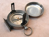 Vintage pocket compass with clinometer function in hunter case