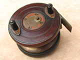 Early 20th century centrepin reel with brass starback & Slaters catch