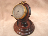 J H Steward 19th century pocket barometer with Rosewood stand.