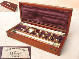 T. O. Blake Sikes hydrometer set with book of spirit tables