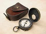 Late 19th century early verners style marching compass with leather case