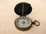 Antique brass cased pocket compass signed 'AITCHISON LONDON'