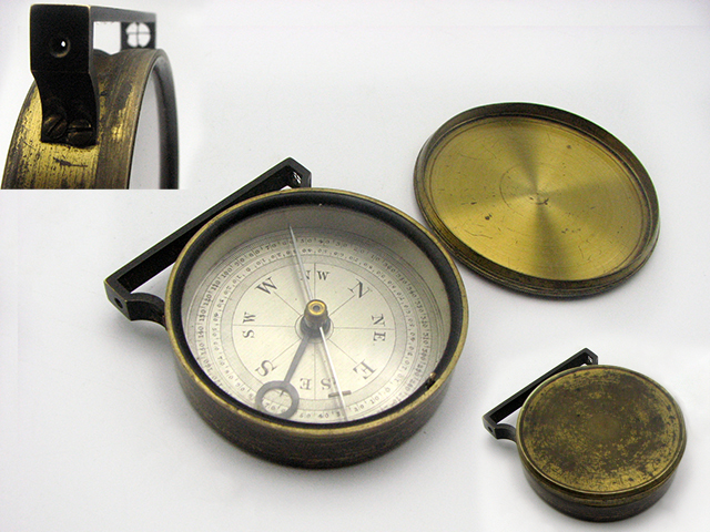 Handle compass with sight arm in upright position
