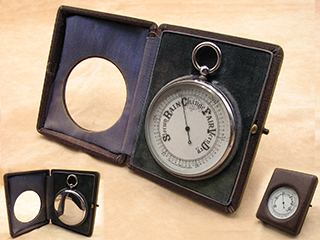 Early 20th century Goliath size pocket barometer in fitted case with stand.