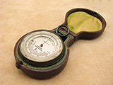 Antique pocket barometer with curved thermometer signed Aitchison London & Provinces