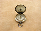 A late Victorian hunter cased pocket compass with gemstone needle