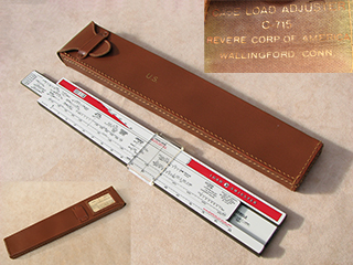 World War 2 case load adjuster sliderule in leather case by Cox & Stevens