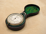 Late 19th century pocket barometer with thermometer  signed 'J BATEMAN 131 High Holborn'