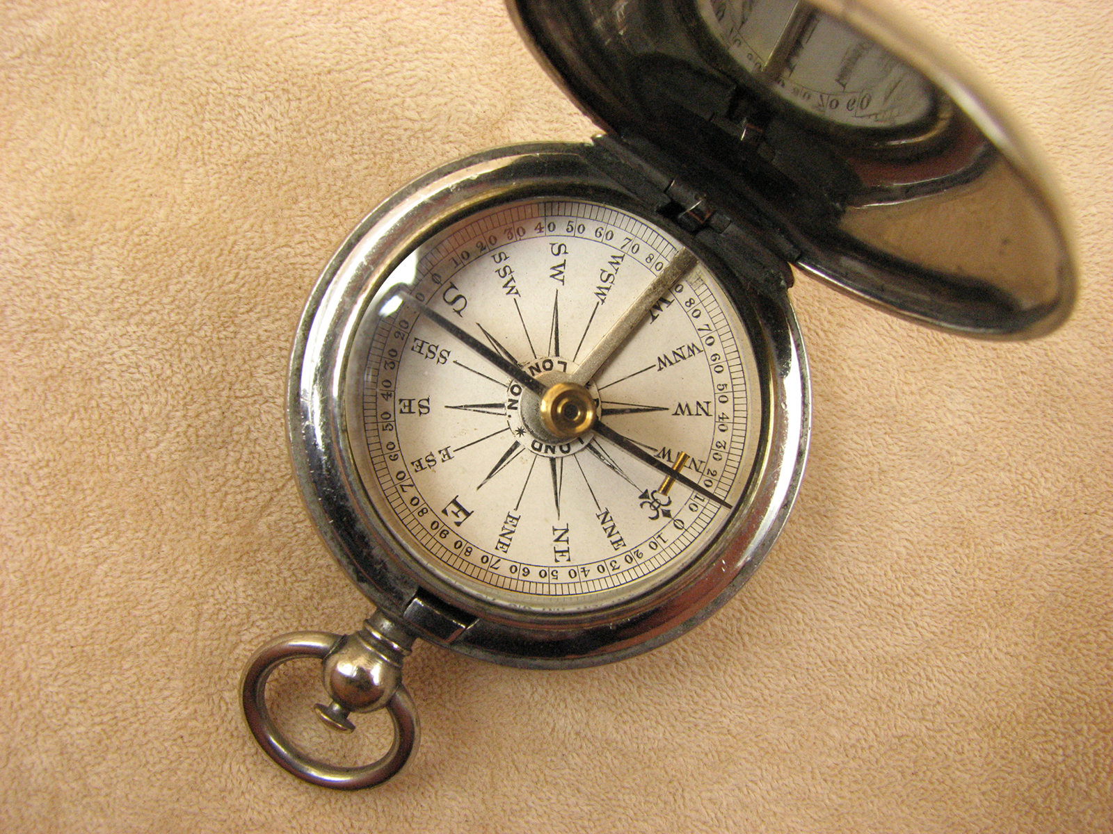 Dollond Victorian hunter cased pocket compass with gemstone needle