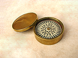 Early Victorian brass cased floating dial compass with domed lid.