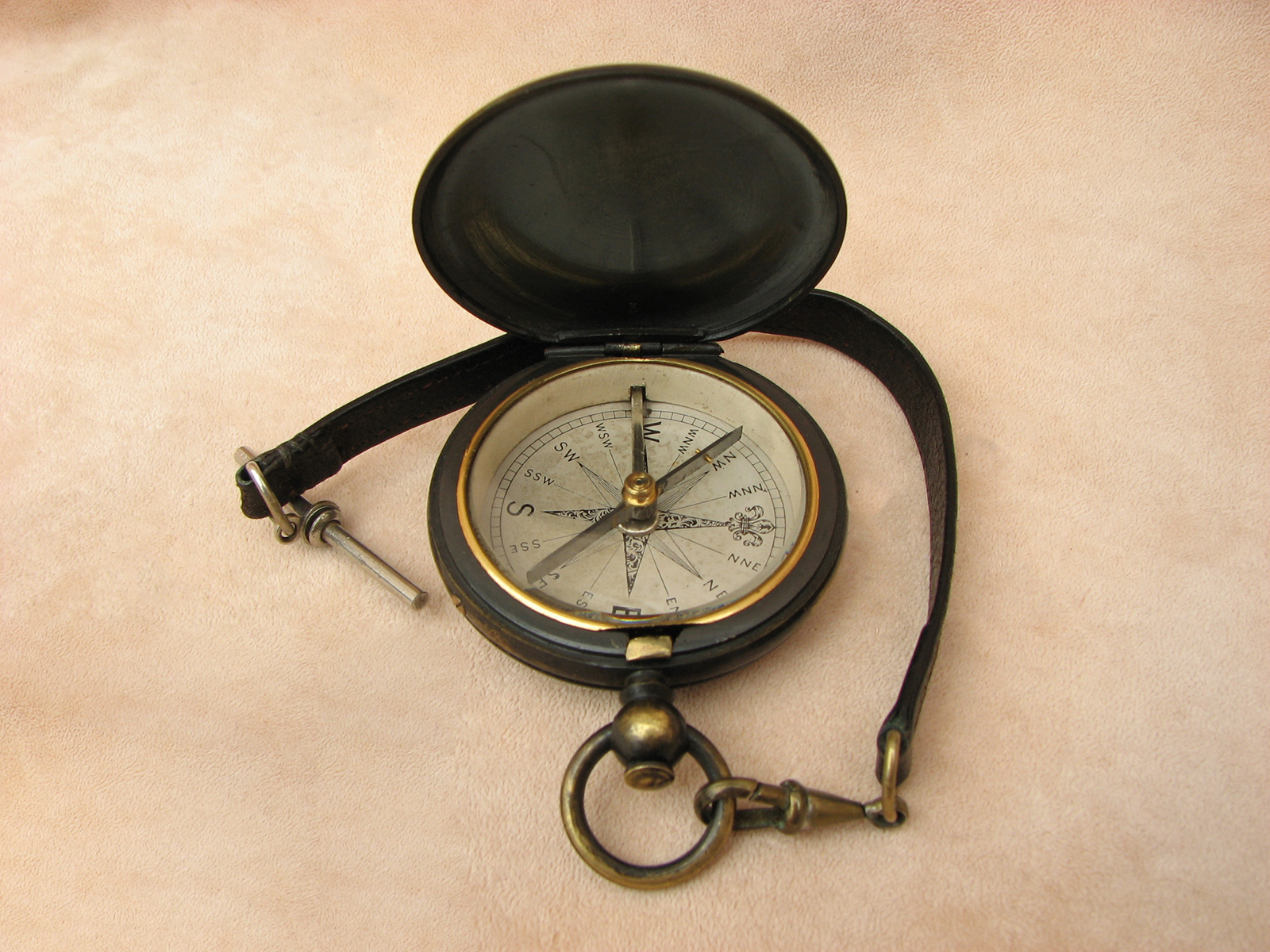 19th Century blackened brass pocket compass with T bar leather strap
