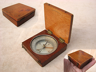 Mahogany cased compass with clinometer arm