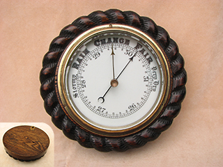 Victorian dark oak cased rope twist aneroid barometer
