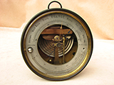 Dubois & Casse brass barometer with open face dial and thermometer, circa 1870.