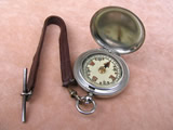 Vintage hunter cased pocket compass with leather strap & T bar