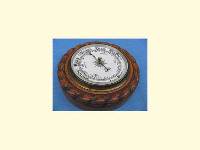 Oak aneroid barometer by J Hall Opticians, Bradford