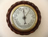 Antique barometer with curved thermometer circa 1885