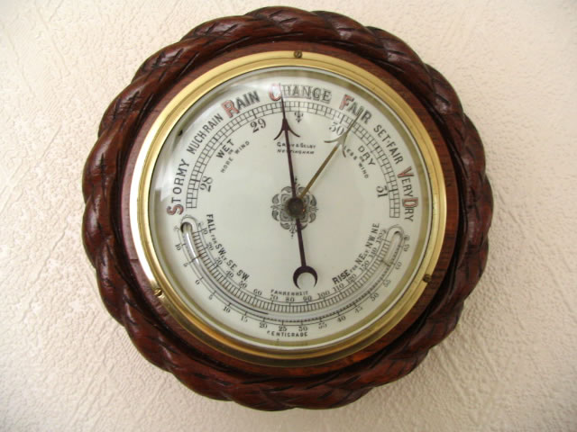 Victorian aneroid barometer with curved thermometer
