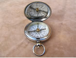 Antique hunter cased pocket compass with cross bar needle