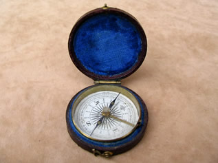 Victorian pocket compass in leather covered case