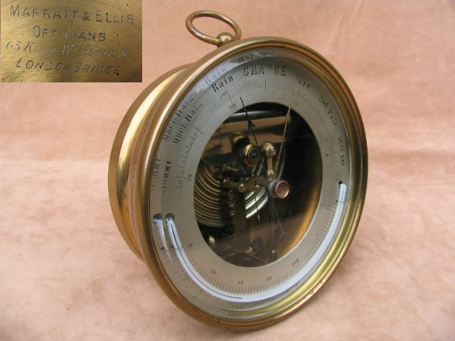 19th century brass aneroid barometer with curved thermometer